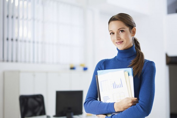 smiling woman standing in office